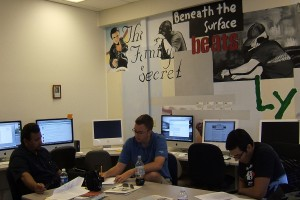 Student Miguel Saucedo, ABC15 multimedia journalist Tim Vetscher and TV producer Jorge Melchor work on broadcast pilot.