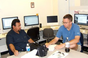 Miguel Saucedo and Tim Vetscher brainstorm a video script.
