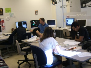 Student Carmela Kelly, Miguel Saucedo, Tim Vetscher and Jorge Melchor work on broadcast projects.