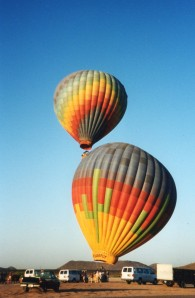 Hot air balloons soar in the bright, blue skies of Arizona as terror fills the skies back East.