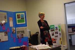 Judy Galbraith, the Puma Press adviser, smiles at students during the open house.
